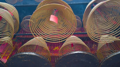 A Lit Spiral Incense Hanging In The Temple