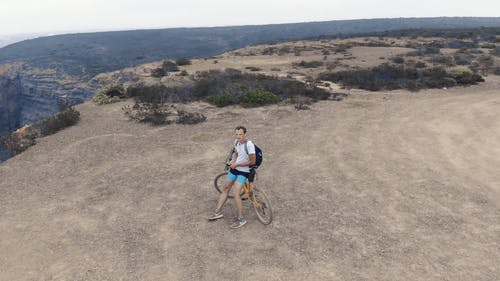 360 Degree Aerial Footage Of The View Point Of A Man On A Mountain Bike