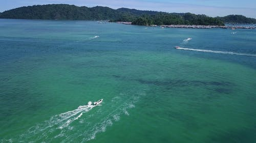 Speedboats Traversing The Sea