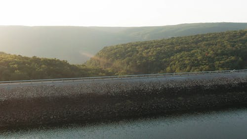 A Road Built On Top Of A Dam Wall