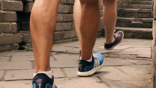 People Wearing Sneakers And Walking In Slow Motion