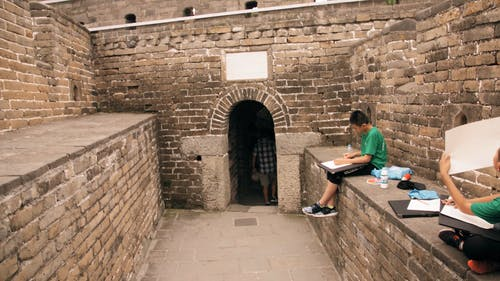 Students Drawing In A Section Of The Great Wall Of China