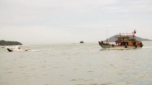 Fishing Boat And Motorboat Travelling