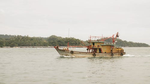 A Fishing Vessel Off To The Sea To Catch Fish