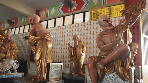 The Many Faces Of Buddha In A Temple In Borneo, Malaysia