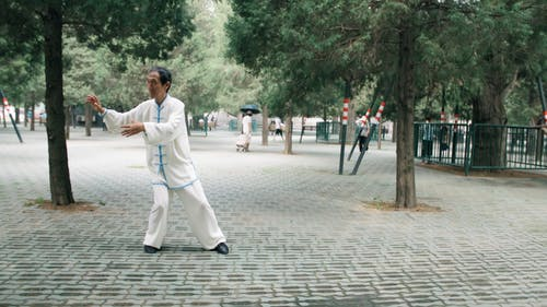 An Old Man Doing A Tai Chi Exercise