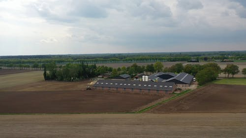 A Modern Farm  Complete With Warehouses And Farms Equipment