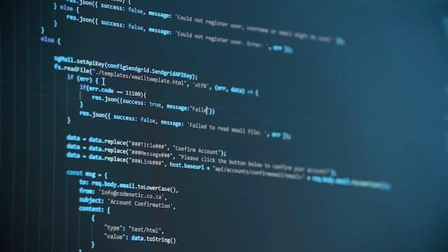 A Computer Monitor Flashing Digital Information