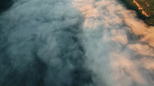 Aerial Footage Of Dense Fog Covering The Surface Of A Lake