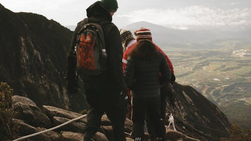 People Trekking On A Mountain Trail