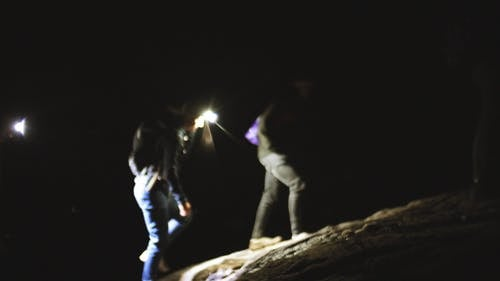 A Group Of Men On A Hiking Trail At Night