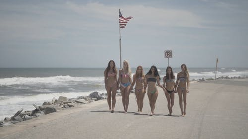 Women Walks With Their Two-piece Swimsuits