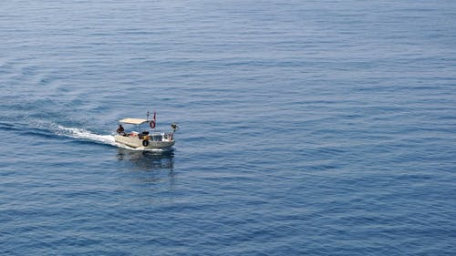 A Fishing Boat Out In The Sea