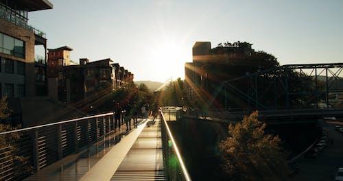 Slow Motion Footage Of Groups Of People Walking A Bridge Walkway