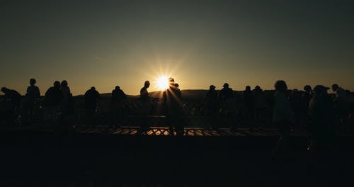 People Watches The Sunset From A View Deck