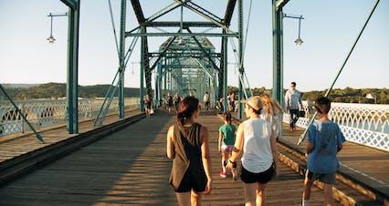 People On A Footbridge Of Steel And Wooden Floors