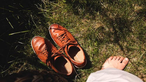 A Leather Shoes Lying On The Grass