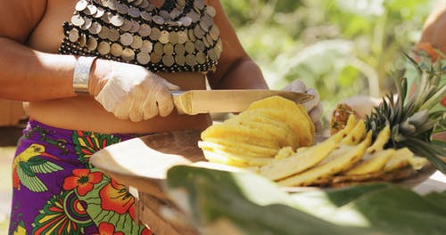 A Woman With Knife Slices A Pineapple