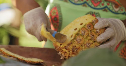 Peeling A Pineapple With Knife