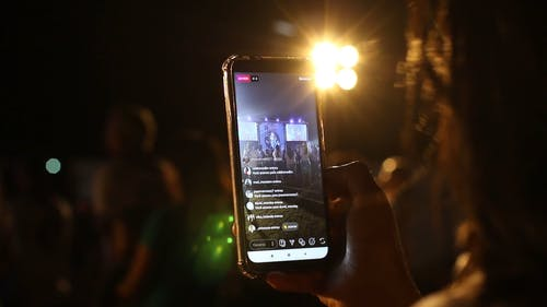 A Person Live Streaming A Religious Event