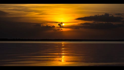 View Of Sunset On A Serene Body Of Water