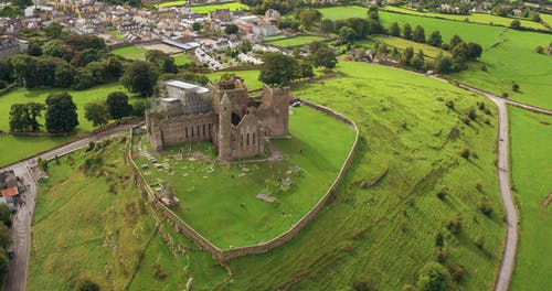 Aerial View Of A Castle Surrounded By Grassland