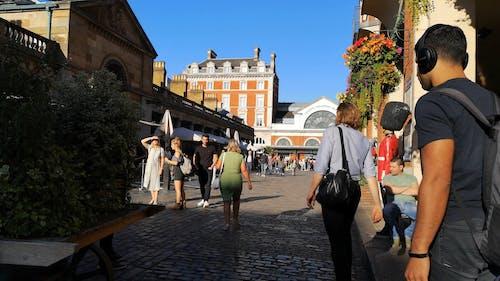 People On A Walk Street In London