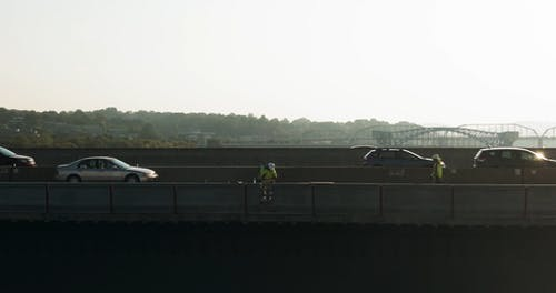 A Man Working On A Concrete Road Barrier