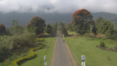 Aerial Footage Of A Beautifully Landscaped Tropical Garden Park Surrounded With A Scenic View Of Lush Mountains