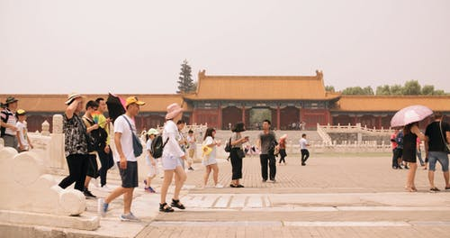 People walking A Courtyard Of A Palace In China