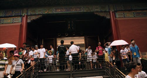 People Exiting A Temple