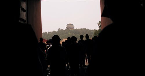 Tourists Enters The Temple Yard In China
