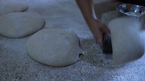A Baker Skillfully Prepares The Dough For Baking