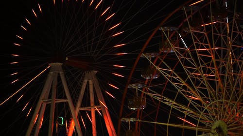 Lights Display Of Observation Wheel In Circular Motion At Night