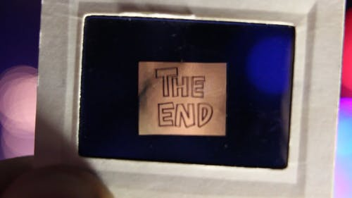 Notice Of The End Projected On A Transparent Blue Film