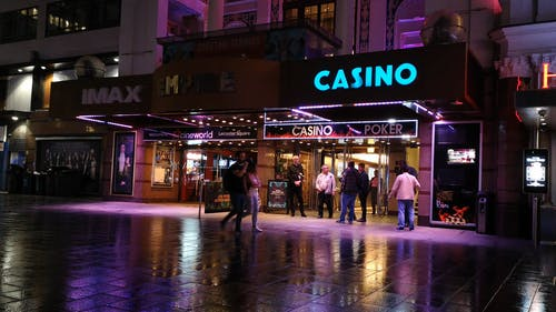 A Casino With People Outside The Building
