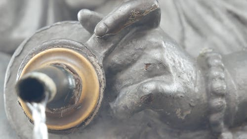 Water Dripping From A Statue