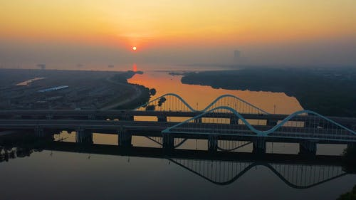 Aerial Footage Of The Bridges Over A River That Flows To The Sea