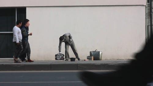 A Street Performer Dancing In The Sidewalk