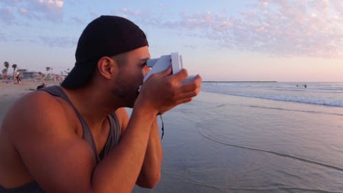 Footage Of A Man Taking A Picture Of The Sea