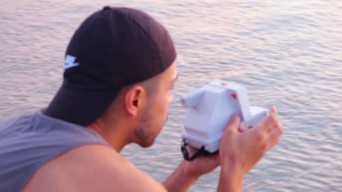 Man Taking Picture With An Instant Camera