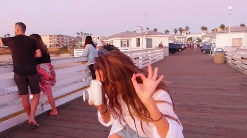 Picture Taking In A Boardwalk