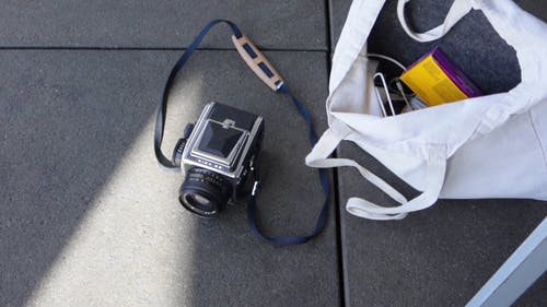 An Analog Camera Lying On A Concrete Floor