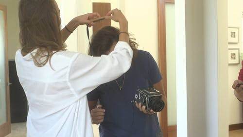 Women Sharing Information About A Digital Camera On Hand