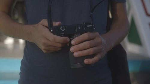 Close-up View Of A Person With A Camera