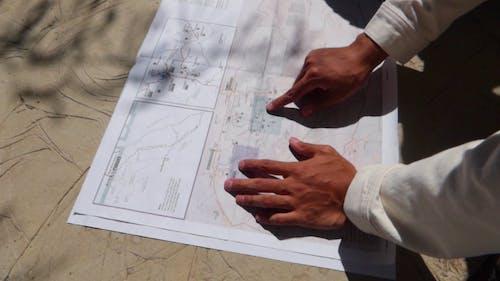 Man Showing A Plan