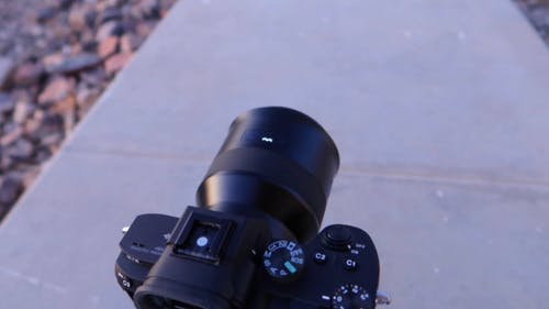Close-up Of A Digital Camera On A Short Tripod On A Pavement