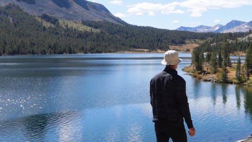 Man Throwing Stone Into The Lake
