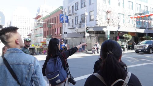 Tourist Pointing To The Street Of China Town