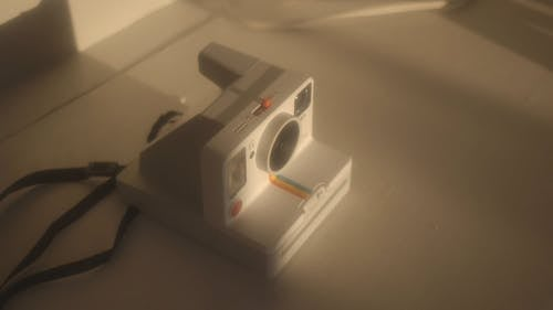 An Old Style Analog Camera On A Flat Surface